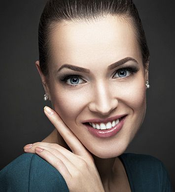 Woman smiling after getting facial procedure from Chicago Plastic Surgery LLC